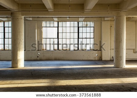 Abandoned Industrial Factory Warehouse Interior - stock photo