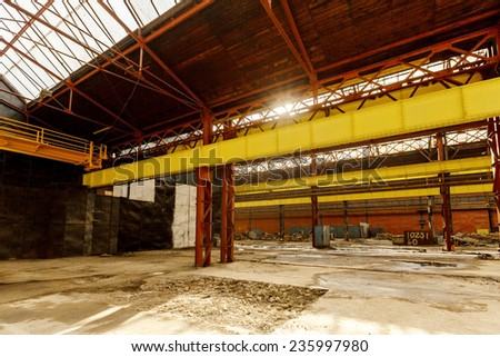 Abandoned industrial interior  with big windows - stock photo