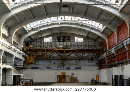 Abandoned industrial interior with door - stock photo
