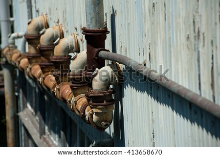 Abandoned Industrial pipes on Cockatoo Island in Sydney - stock photo
