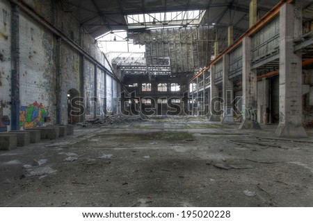 Abandoned large empty warehouse in East Germany - stock photo