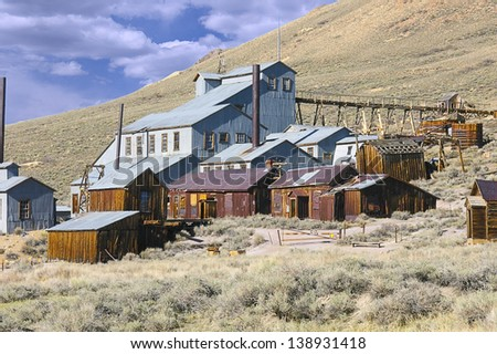 Abandoned mine buildings at Bodie State Park, California. - stock photo