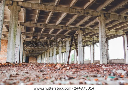 Abandoned modern construction - empty warehouse - stock photo