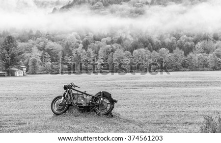 Abandoned motorbike on a meadow.