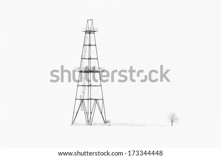 Abandoned oil and gas rig isolated on snow white background - stock photo