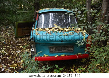 abandoned old car - stock photo