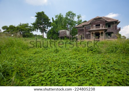 abandoned old house at day - stock photo