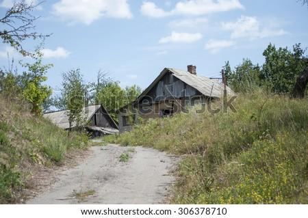Abandoned old house in ukrainian village - stock photo
