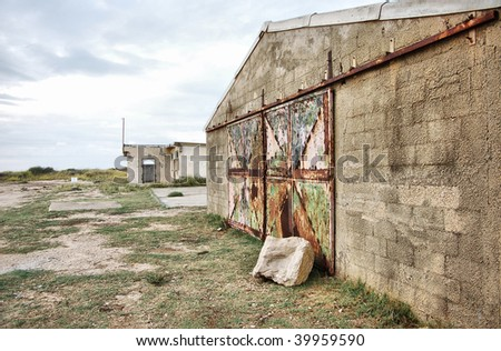 abandoned old rusted warehouse - stock photo