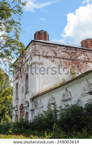 abandoned old stone building overgrown grass in the Park - stock photo