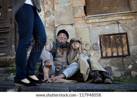 Abandoned people on the street are asking for money - stock photo