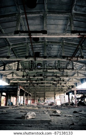 Abandoned plant horrible, dirty and symmetric interior - stock photo