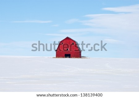 Abandoned red barn in snow - stock photo