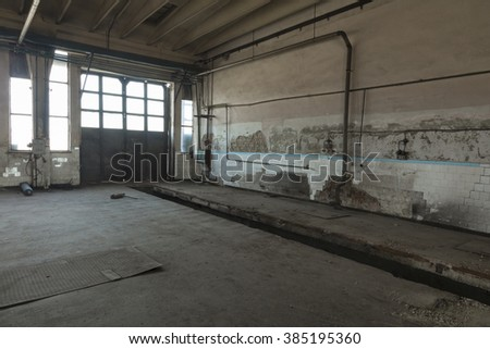 Abandoned room in old factory. Grungy walls - stock photo