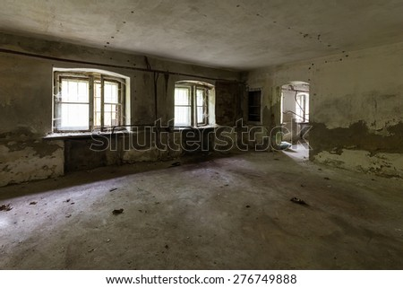 Abandoned room in the destroyed building - stock photo