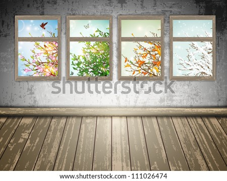 abandoned room with a Four Season windows: spring, summer, autumn and winter - stock photo