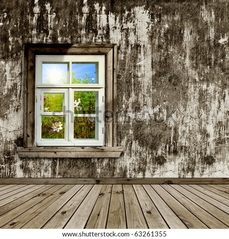 abandoned room with a window overlook the garden - stock photo
