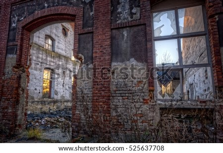 Abandoned ruin - brick wall with window and the door