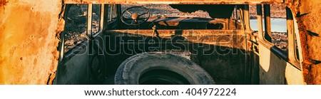 Abandoned rusty car. Toned photo - stock photo