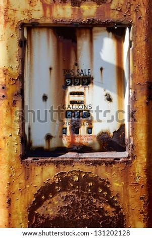 Abandoned rusty gas pump - stock photo