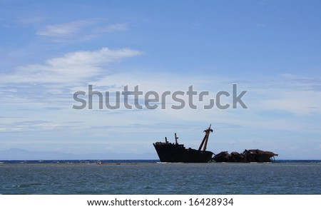 Abandoned Ship in the Water - stock photo