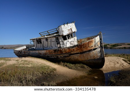 abandoned shipwreck in the bay - stock photo