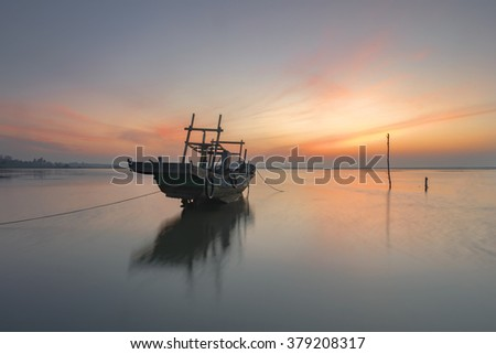 Abandoned shipwreck on the beach during sunrise