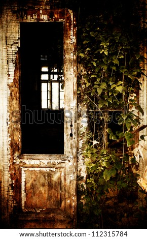 abandoned spooky front door; vintage textured old house - stock photo