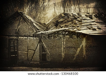 Abandoned spooky house on textured background - stock photo