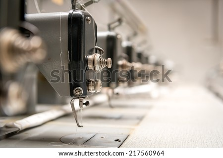 Abandoned textile factory - sewing machines - stock photo
