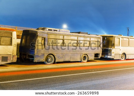 abandoned transport metropolis, traffic and blurry lights of cars on the highway and multiband dense road traffic at night in Moscow - stock photo