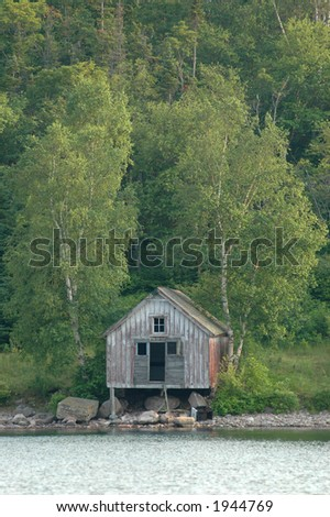 Abandoned waterfront shack in Northern Ontario - stock photo