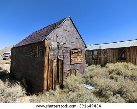 Abandoned wood and rusty metal shack in ghost town of Bodie, California - landscape color photo