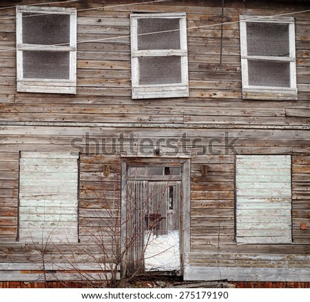 abandoned wooden house with boarded up windows - stock photo