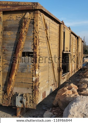 Abandoned wooden railway car on props