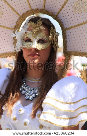 "ABANO TERME, ITALY - MAY 8, 2016: Participants of the public open masquerade festival ""La maschera alle Terme""  shown on May 8, 2016 in Abano Terme, Padova, Italy. The festival is held annually"