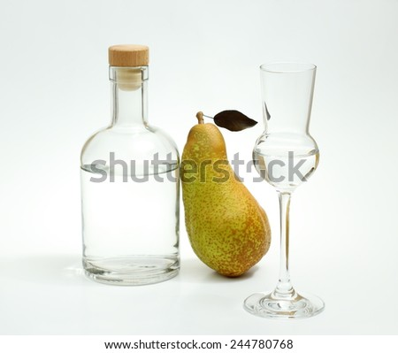 Abate Fetel pear with alcohol bottle and glass on white background - stock photo