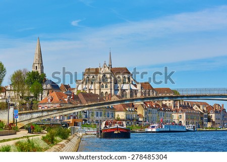 Abbey of Saint-Germain d'Auxerre, reflecting in river Yonne, Auxerre, Burgundy, France - stock photo