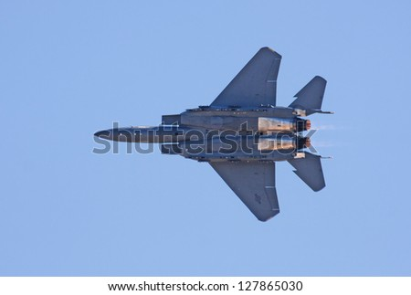 ABBOTSFORD, CANADA - AUGUST 14: United States F-15 performs aerial maneuvers over the skies at the Abbotsford International Airshow on August 14, 2010 in Abbotsford, Canada - stock photo
