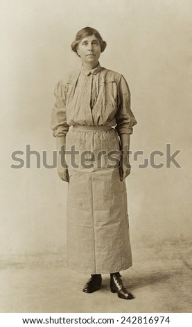 Abby Scott Baker, models a prison dress. She was imprisoned for picketing in Washington, D.C. and wore her prison uniform on the militant National Women's Party 'Prison Special' tour in Feb-Mar 1919.