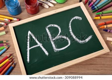 ABC alphabet written on a small blackboard - stock photo