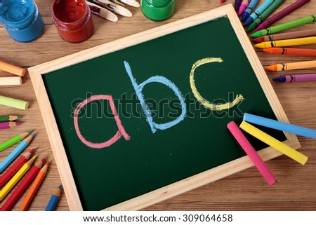 ABC basic alphabet, preschool education, blackboard, school desk,  - stock photo