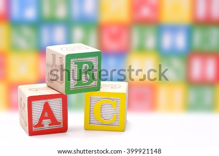 ABC blocks on a colorful blurred background - stock photo