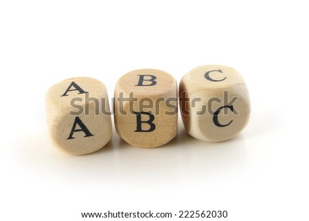 abc, spelled with wooden alphabet blocks, education toy to learn reading and writing, isolated on white background - stock photo