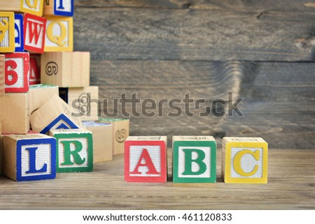 ABC text on wooden table