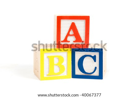 ABC wooden blocks stacked vertically isolated on white