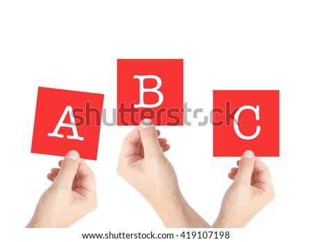 ABC written on cards held by hands