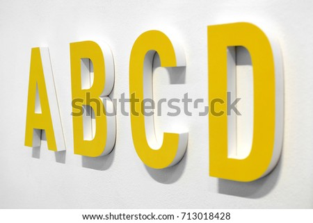 Worksheet A B C D In Vertical Letter abcd stock images royalty free vectors shutterstock yellow alphabet letters mounted on a white wall with shadow viewed at an oblique angle