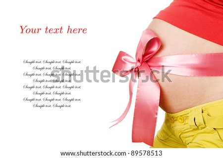 Abdomen a young pregnant woman tied with a Red ribbo and a sample of text. isolated on white