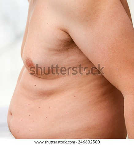 Abdomen of fat man - stock photo